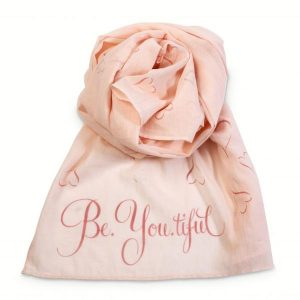 Wrap yourself up in this stylish soft Peach coloured scarf. Adorned with the slogan 'Be, You.Tiful' alongside an inspiring heart print it is sure to make a statement this Season.
