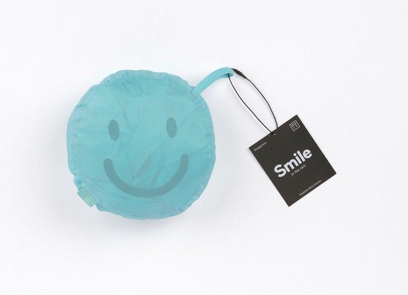 Blue Smile Raincoat In A Bag