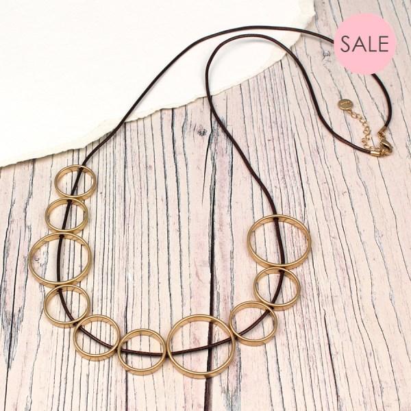 Golden Circles on Long Dark Cord
